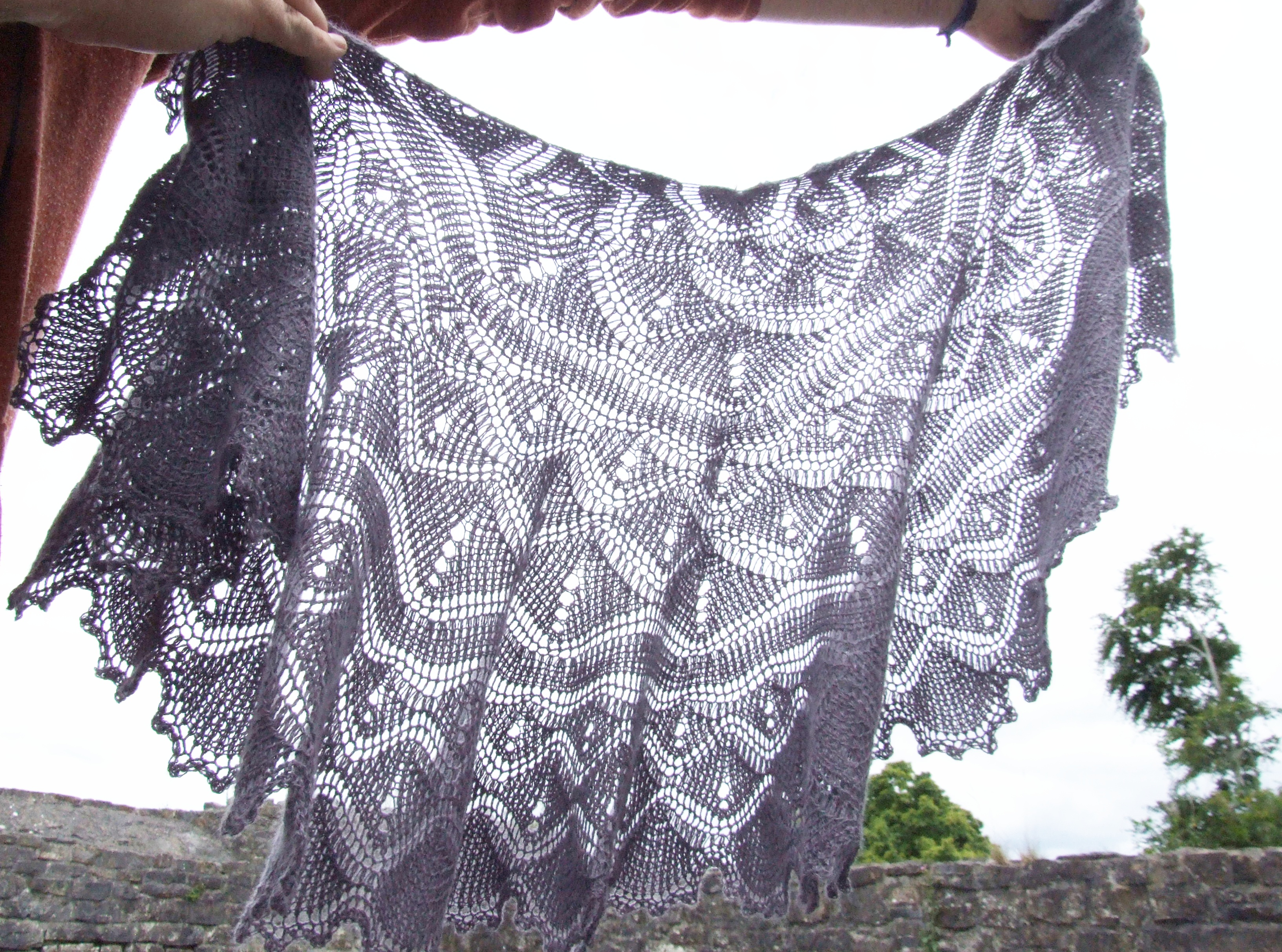 sun shines through a violet tunisian crochet shawl